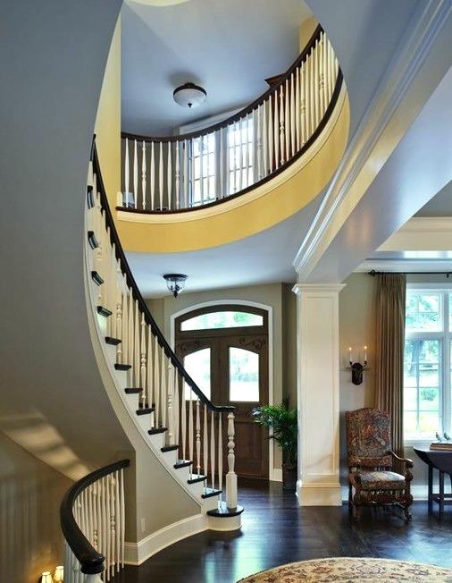 Curved Stairway And Front Door